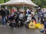 Komunitas Pemuda Peduli Kesehatan Masyarakat (PPKM) kota  Balikpapan membagikan 400 nasi kotak bagi masyarakat yang sedang menjalani Isolasi Mandiri (Isoman) pada Jumat (16/7/2021). Foto : BorneoFlash.com/Muhammad Eko.